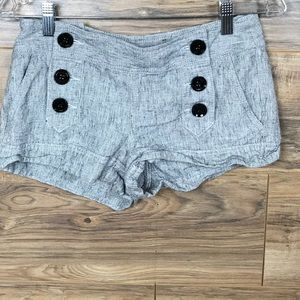 Small Express shorts with 6 buttons in the front.